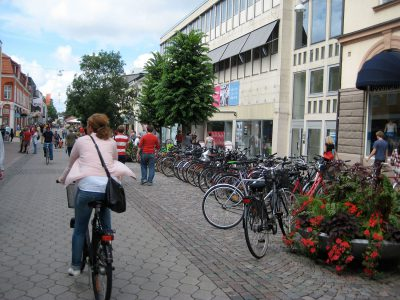 The City center of Växjö, Sweden features a bike-friendly pedestrian mall, with plenty of outdoor seating, street trees, and planters that make the most of a short summer season.